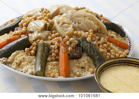 Traditional Moroccan couscous with buttermilk sauce in a bowl