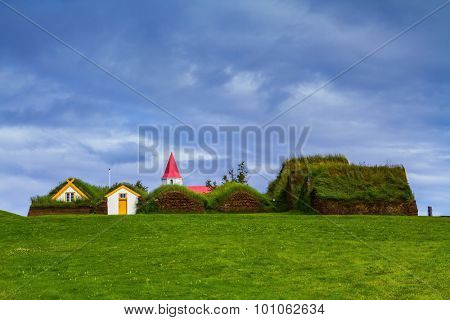 The village ancestors. The reconstituted village - a museum of the first settlers in Iceland. Roofs of houses covered with turf and grass