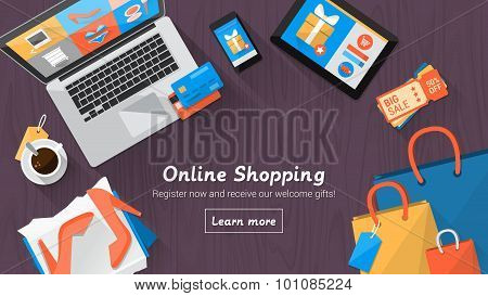 Online shopping concept desktop with computer table shopping bags credit cards coupons and products poster