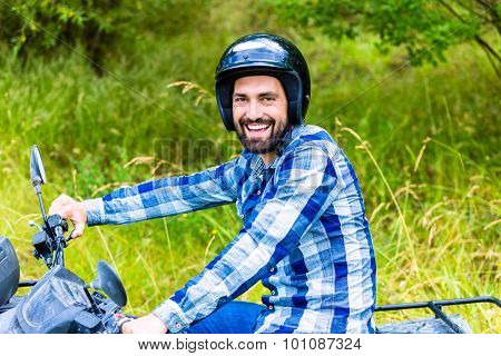 Man driving off-road with quad bike or ATV poster