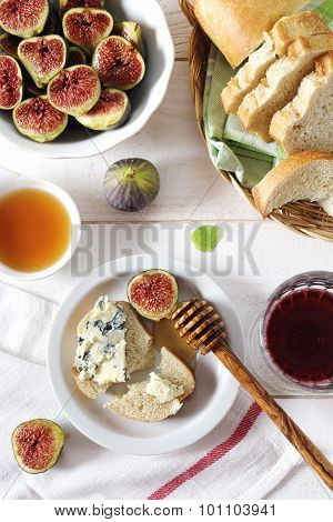 Ripe Figs, Blue Cheese, Baguette And Wineglass