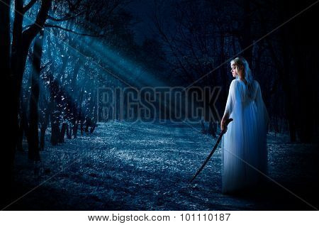Young elven girl in night forest