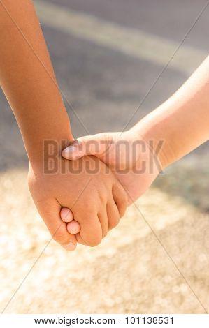 Children Hand In Hand Support Concept