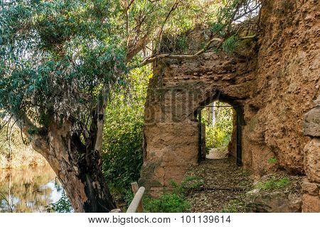 Door inside the rampart of medieval stone that surrounds village of