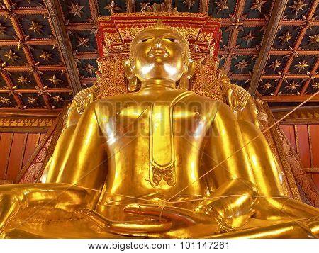 Big golden Buddha in ancient Buddhist temple - Wat Phumin,  Thailand.