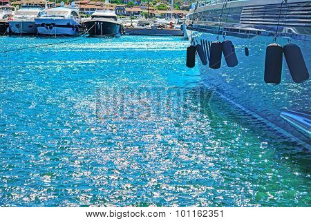 Harbor Water Reflected In A Yacht Hull In Porto Cervo