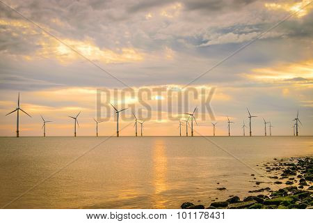Sunset Offshore Wind Turbine In A Wind Farm Under Construction