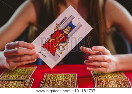 Fortune teller using tarot cards on black background poster