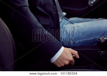 Driver Pulling Handbrake Lever In Car