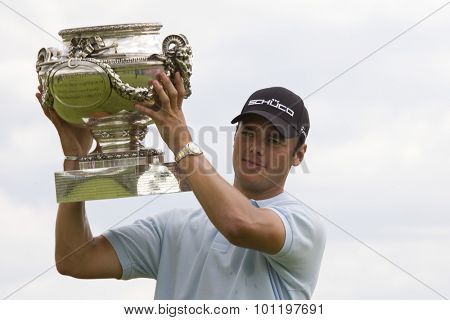 PARIS FRANCE, 05 JULY 2009. Martin Kaymer (GER) holds the trophy aloft after winning the PGA European Tour Open de France golf tournament.