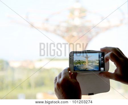 Milan, Italy - 8Th September, 2015. Expo Milano 2015. Tree Of Life And Smartphone