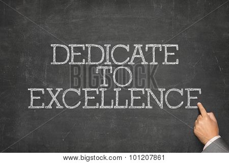 Dedicate to excellence text on blackboard