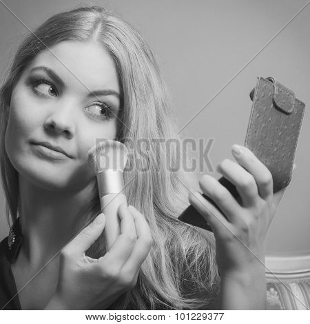 Attractive Woman Applying Make Up With Brush.