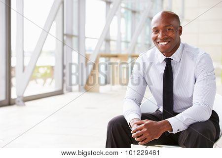 Smiling African American businessman, horizontal portrait