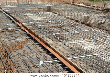 Floor slab reinforcement bar on timber formwork at the construction site