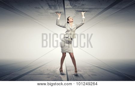 Young troubled businesswoman trapped between two walls