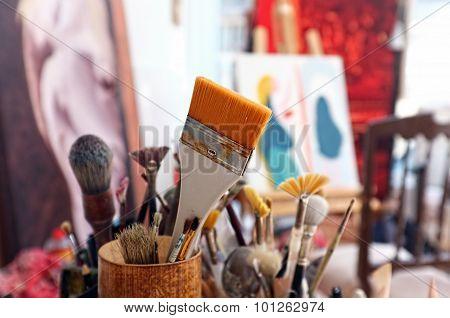 Artist brushes in a studio