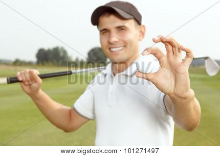 Handsome young man playing a game of golf