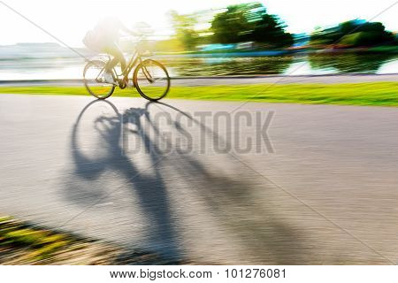 Person On Bike Casting Shadow