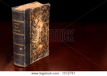 Old German Bible Standing On A Table