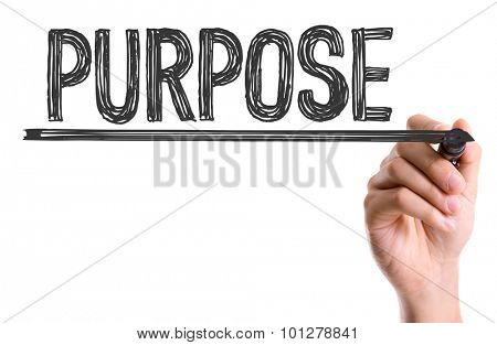 Hand with marker writing the word Purpose