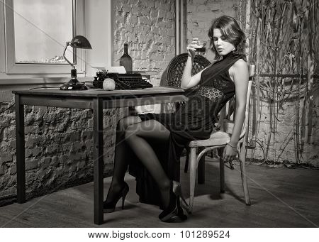 Elegant Woman In Black With The Old Typewriter