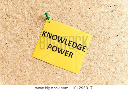 knowledge power word typed on a paper and pinned to a cork notice board poster