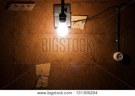 Old white electric socket and a bulb