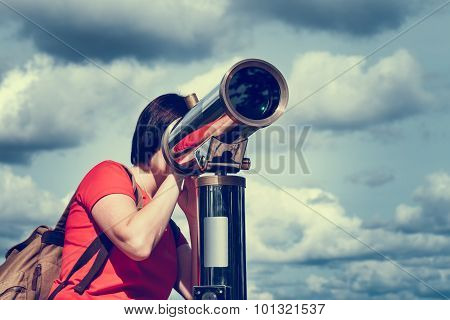 Young Woman Looking Through Tourist Telescope, Exploring Landscape.
