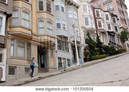 Woman Walks Up Steep Incline On Nob Hill Street