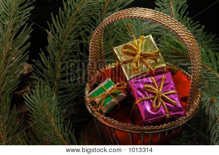 Basket Of Presents In Tree Boughs