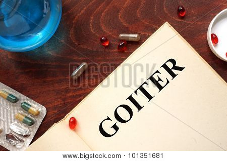 Goiter written on book with tablets.