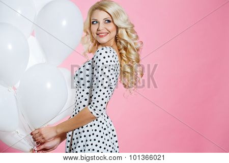 Studio portrait of the beautiful woman with balloons