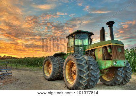 Vibrant sky over farm tractor