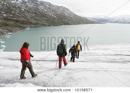 Explorers In A Glacier