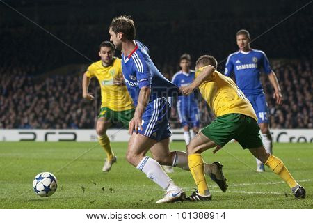 LONDON ENGLAND 23 NOVEMBER 2010.Chelsea's defender Branislav Ivanovic gets his shirt pulled by MSK Zilina's defender Stanislav Angelovic during the UEFA Champions League