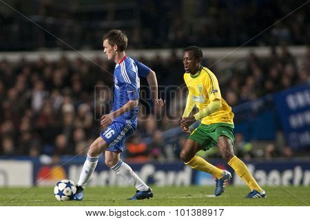 LONDON ENGLAND 23 NOVEMBER 2010. Chelsea's midfielder Josh McEachran and MSK Zilina's forward Bello in action during the UEFA Champions League match between Chelsea FC and MSK Zilina