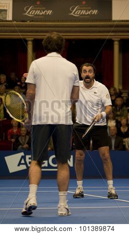 LONDON, ENGLAND. 05 DECEMBER 2009 -   Henri Leconte (FRA) shots at his partner Cedric Pioline (FRA) while competing in the season finale to the ATP Champions Tour