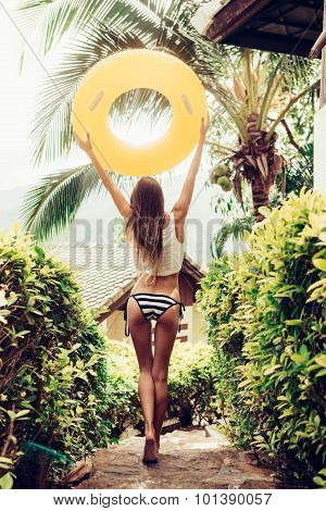 Beautiful Slim Girl In Sexy Striped Bikini Walking Down The Stairs In A Tropical Garden