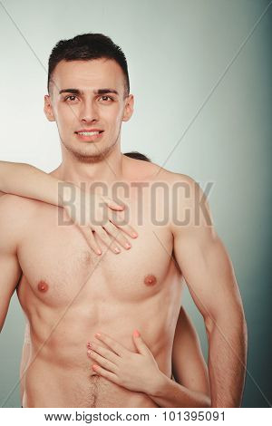 Sexy passionate couple lovers in studio. Woman hands embracing handsome half naked semi nude man. Love and passion. poster