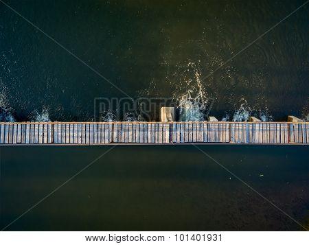 river a diversion dam with a footbridge - aerial view with a copy space - Cache la Poudre RIver in northern Colorado