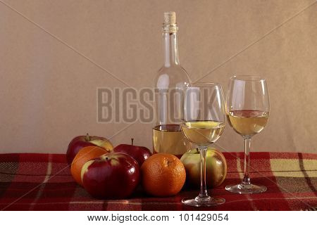 Bottle Of Wine Two Glasses And Fruits