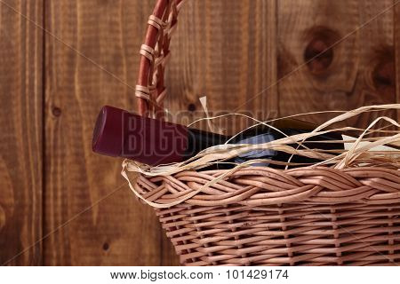 Bottle Of Wine With Straw In Basket