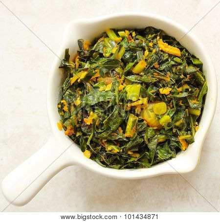 Pan roasted collard leaves with shredded coconut top view