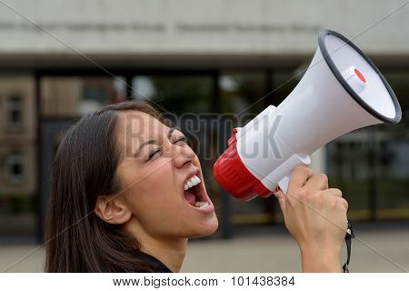 Angry Young Woman Yelling Over A Megaphone