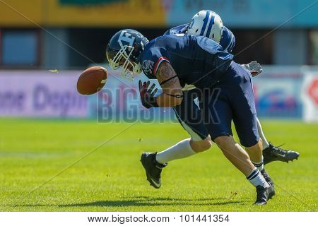 VIENNA, AUSTRIA - JUNE 7, 2014: WR Steve Delaval (#4 France) is tackled by DB Pekka Rantala (#4 Finland).