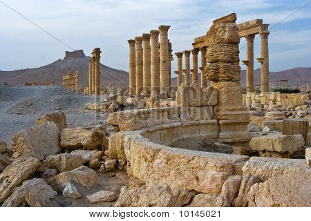 The arab castle of Qalat Ibn Maan and the columns of the ancient city of Palmyra poster