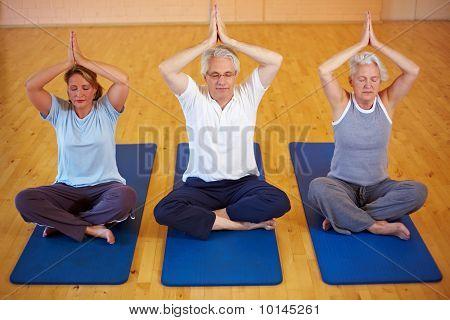 Three People Doing Yoga