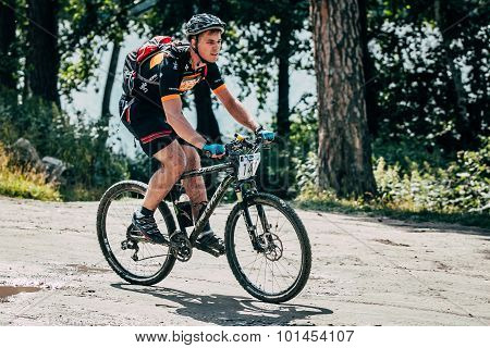 mountainbiker rides along lake