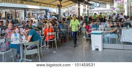 People Sitting At The Tables In Vienna